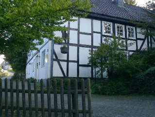 Renovated half-timbered farmhouse from 1780 in hilly area