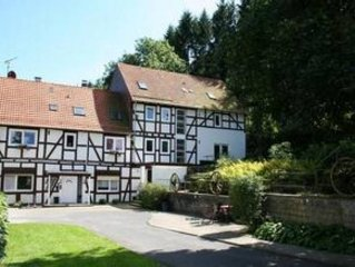 A former water mill, suitable for twenty-two people, just four kilometres from