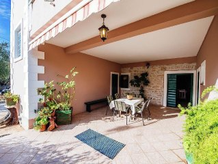 Spacious ground floor apartment, big private covered terrace, 200 m from the sea
