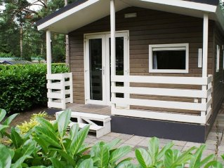 Detached chalet in a forested setting, in a holiday park with a pool and more