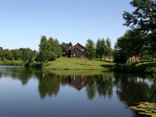Holiday home in beautiful location by lake in large nature reserve of Northern