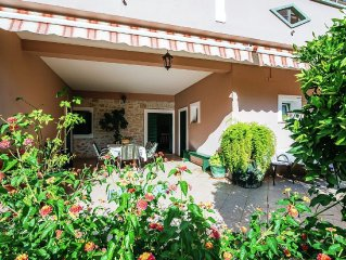 Ground floor apartment 200 meters from the beach, private terrace,free Wi Fi