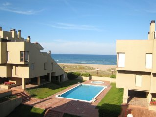 Nice apartment in Spanish style with communal swimming pool and at the beach