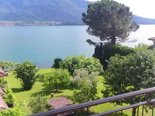 Apartment with large garden is located right on the lake and has a beautiful vi