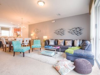 Elegant 3-story townhome with covered garage and room for 10 guests.