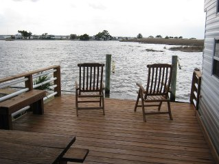 Kick back and relax on a private deck overlooking the Bay in Sandbridge.