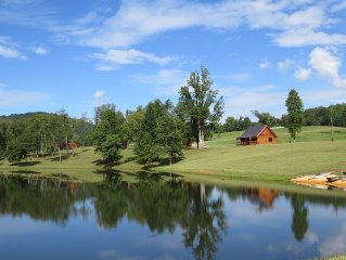 Amazing Log Cabin On 200 Acres Overlooking Private Lake.