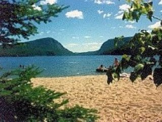 Willoughby Lake Cottage with Private Sandy Beach, Spectacular Mountain Views