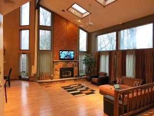 Large Contemporay 3 Story Home in a gated community with 2 Pools & a Lake!