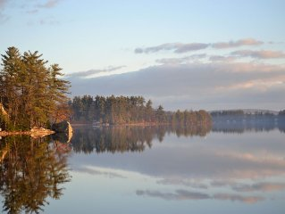 The Wee White Cottage on Tripp Lake in Poland, Maine.