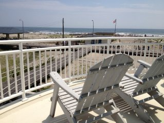 Unreal Location - Step out onto the boardwalk in this beachfront home.