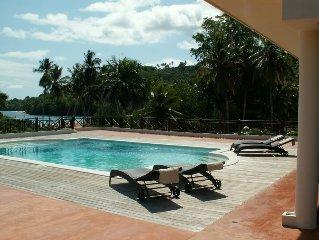 A Luxury beachfront villa with semi-private sandy beach near famous Rincon Beach