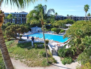 Waterfront Condo with Old Florida Charm, Wrap-Around Balcony & Large  Pool!
