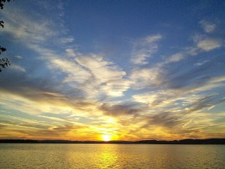 Lake Leelanau Cottage with Sunset View . . . Prepare to Relax!