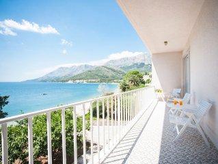 Modernist beach villa with quiet Mediterranean terraced gardens