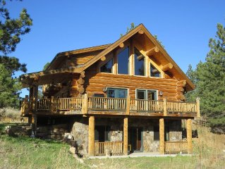 Nearly New Hand-Hewn Log Home on 11 Secluded Acres