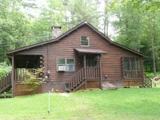 Secluded Log Cabin with a 6-Person Hot Tub, Private Pond and Babbling Brook