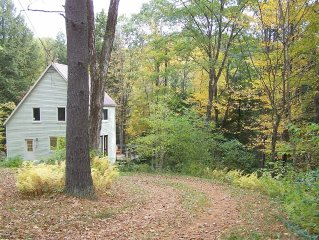 Attractive saltbox home in woods
