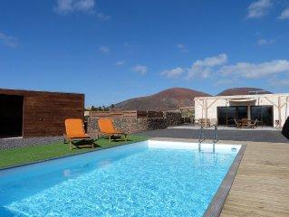 Maison avec piscine, vue sur volcans, jardin, WIFI