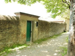 House with private garden, in Cortona's town centre