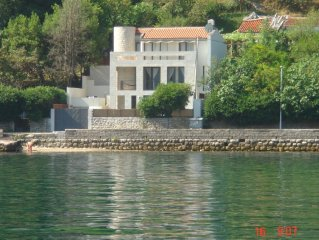 Lovely modern stone villa with pool on the sea front in Prcanj, ME