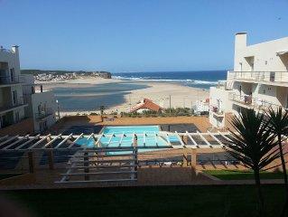 Beachfront Family- friendly Apt. w/ WI-FI. 3 Pools, & within steps of   Beach