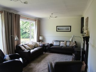Cottage with sunny/secure garden, parking pet friendly. Near pub/shop/beaches