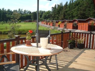4 star Luxury Lakeside Pine Lodge ( with sauna) in secluded Shropshire setting
