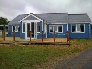 This three bedroom cottage with sea views sleeps 6