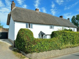 Pet friendly Grade II listed cottage in village with shops, pubs & great walks