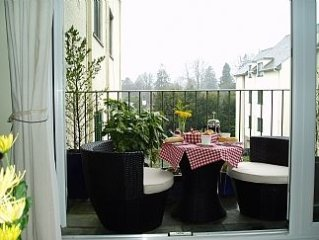 The Apartment Has A Balcony With Seating Looking Out Towards Claife-heights