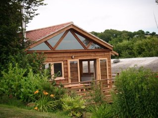 Charming Wooden Lodge With Views Across The Valley To The Viaduct And The Sea Be