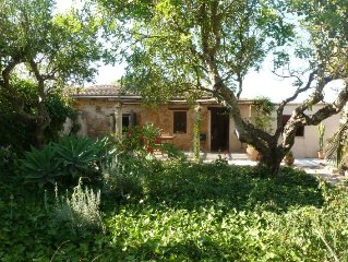 A charming rural cottage surrounded by mature gardens near Cala Mesquida beach.