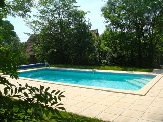 Attractive typical village house with  large garden and fenced pool.