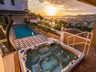 Modern luxury villa with jacuzzi, a private pool, garden, terrace and sea views