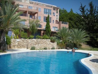 Lovely Secluded Apartment with WIFI on Exclusive Complex with Gardens & Pool