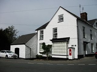 Cottage Is Situated In The Village Centre With A Patio Overlooking The River