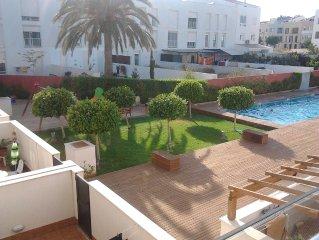 piscina comunitaria + jardín swimming pool