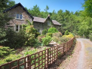 Large country house with outdoor hot tub and BBQ house and lovely gardens.