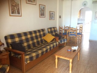 Spacious mid floor self contained apartment on a complex with communal pool