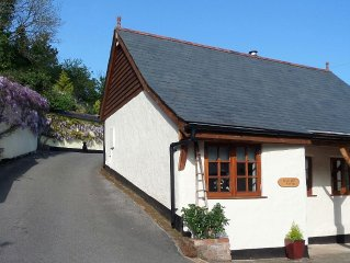 Charming Character Cottage in lovely Village setting. 5 * rated