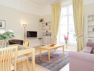 Delightful bright and airy with high ceilings and access to two small balconies