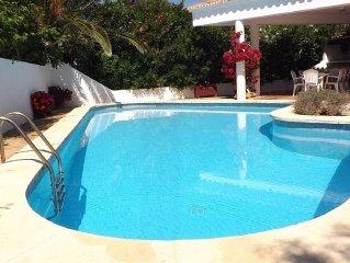 Spacious villa with huge pool by sandy beach,coastal walks & local restaurants.