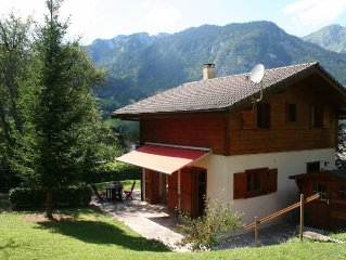 Delightful Chalet, village location, garden, parking, views and WiFi