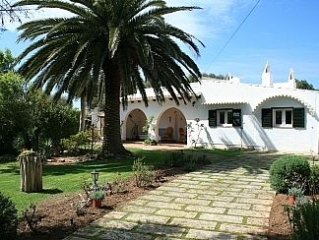 Menorcian house with secluded, spacious gardens,pool and great outside kitchen.