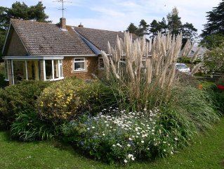 Bungalow with cottage garden close to sandy beach.  Sleeps 4 and free Wi-fi.