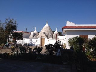 Spacious trullo and integral villa, with pool, set in olive grove 2km from town