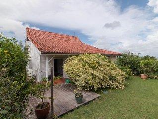 Villa la Douce  Creole . Chambres climatisees /vue sur mer /  /1 K m Plage