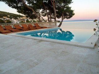 Seafront villa with heated swimming pool, teak deck, open sea view, boat mooring