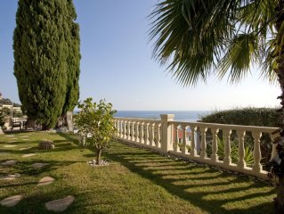 Luxury villa apartment with panoramic sea views and small private garden